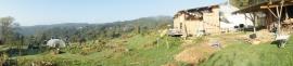 La forge et l'atelier - la yourte et la véranda - le potager - la vallée de la dordogne